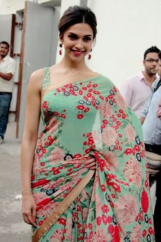 Beautiful sea foam floral saree on Deepika :) love! Be sure to check out similar designs on Xarii.com! xoxo