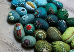 lil fish studios felted embroidered stones.  Paint real ones?