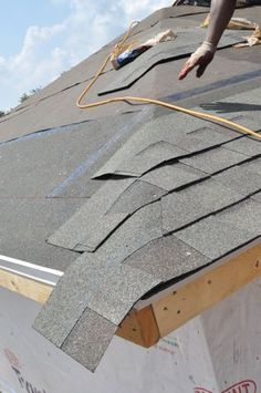 A couple of weeks ago we published a two-part series showing how a local roofing contractor shingled a roof with architectural shingles. This Project Guide is a combination of those two articles, and it covers replacing the existing roof decking, installi Roof Flashing, Ice Dams, Architectural Shingles, Hip Roof, Roof Top, Roofing Contractors, Building A Deck, Building Plans, Roof Repair