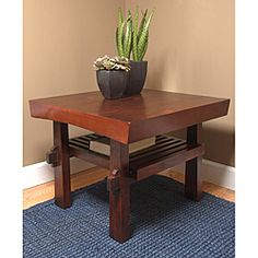 @Overstock.com - Sakura End Table - Add a simple, sophisticated look to your living room with this cherry walnut end table. The attractive design features two shelves for storage space, and the dark cherry finish complements any furnishings. Solid pine wood material provides durability.  http://www.overstock.com/Home-Garden/Sakura-End-Table/4719344/product.html?CID=214117 $103.49