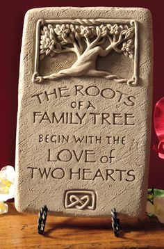 """Honor a family strong in love with this beautiful, meaningful stone. Designed by sculptor George Carruth, hand-cast in concrete and hand finished with a soft wash, it will develop a lovely patina if hung outdoors on a garden wall or gate. 8 1/4"""" H x 5 1/4"""" W x 1"""". 3 lbs. Wire hanger hook. Made in USA"""