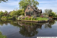 Giethoorn - often called the Dutch Venice, located about 75 miles NE of Amsterdam, has roughly 180 bridges that crisscross over the canals that run throughout the town. The only modes of transportation are your feet, boat or bike.  No cars.