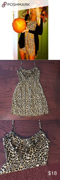 Leopard print dress Beautiful little leopard print dress that can be worn year round. Worn only once (1st pic) and I paired it with a belt and cardigan. Features slight ruffle accent at the top. Perfect condition. Make a reasonable offer, thanks for looking ☺️ Dresses