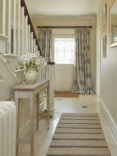 Add a scallop table to narrow hallways so you have a place for keys, letter and flower!