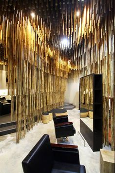 Salon in Bangkok by NKDW, Thousands of bamboo rods hang from the ceiling like stalactites to divide the space inside this Bangkok hair salon by Thai designer Nattapon Klinsuwan of NKDW.