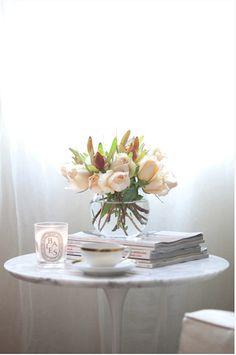 Saarinen tulip table, fresh flowers, magazines, Diptyque candle, reading nook [L]