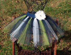 This Navy blue, bright green, white tutu will be a great addition to any sport princess wardrobe.    Every tutu features a soft and stretchy crotchet