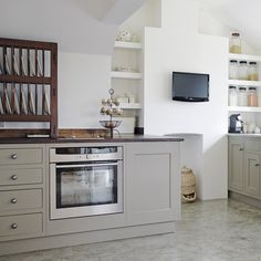 """Soft grey kitchen...cabinet color is """"Mouse's Back"""" by Farrow & Ball"""