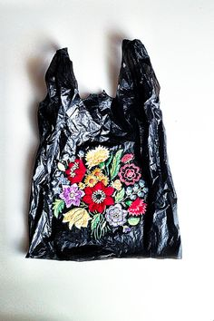 El Barrio Bodega by artist Nicoletta de la Brown I just really liked the incorporation of something beautiful and floral and natural to a simple plastic bag, almost up-cycling or recycling it to turn it into something appealing again, and to help the environment that it is now inseparable from.