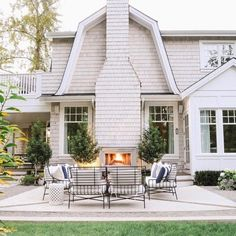 Enjoy the soothing crackling flames during autumnal gatherings with the top 60 best patio fireplace ideas. Explore gas and wood burning designs. Best White Paint, White Paint Colors, Exterior Paint Colors, Paint Colors For Home, White Paints, Gray Paint, Exterior Design, Most Popular Paint Colors, Painting Baseboards
