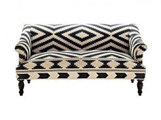Sofa covered in a beautiful black and white ethnic flatweave.