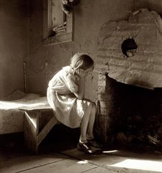 "December 1935. ""Resettled farm child, from Taos Junction to Bosque Farms project, New Mexico."""