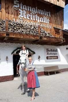 Peaches Geldof sits on a lipizzan horse held by hotel owner Maria Hauser at the Stanglwirt Hotel on August 23, 2010 in Going, Austria. IT-Girl Peaches, daughter of singer Bob Geldof, came to Tirol for a photo session at the Bio-Hotel Stanglwirt. The traditional dress of owner Maria Hauser fascinated her and she wanted to wear for this picture on a white lipizzan horse in front of the 'Wilder Kaiser' mountain the traditional 'Weisswurst-Party' Dirndl.  |  S❤