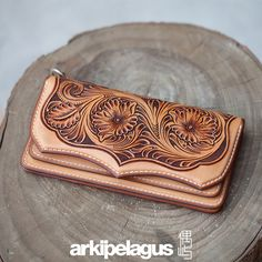 Leather carving Long Wallet (Designer Alleron Yang) by Arkipelagus Workshop;  I'd buy it just to give it as a gift :)