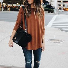 This is something I would wear on a regular basis minus the bag. I love the color of the sweater and how it's loose fitting. Also really like the jeans