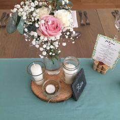 Centre de table réalisé par l'équipe de Magnificia pour un mariage aux Sources