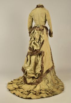 LOT 381 OSTRICH FEATHER-TRIMMED BUSTLE GOWN, 1876 - whitakerauction