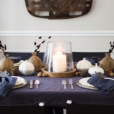 We love @carlaaston's rustic fall table using cement pumpkins and a wood glass hurricane from At Home.