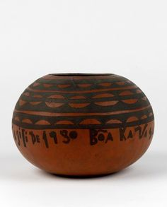 Africa | Vessel from Angola | Gourd / calabash; stem cut off leaving hole mouth. Blackened hatched and cross-hatched bands with straight and curved edges around mouth and upper body and band of inscription below: Misa dausili de 1930 Bea Ka Va Sa.