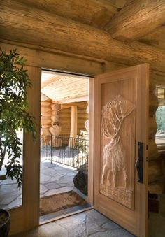 If i had big country to build..,  id pick this door.                                                    carved door   Pioneer Log Homes Of BC