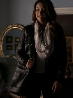 Emily's black jacket with infinity scarf