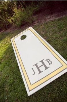 Monogrammed corn hole boards for during the reception