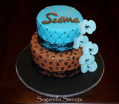 Beautiful leopard cake with sugar flower called orchid. For more ideas go to www.SugarellaSweets.com