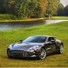 The Aston Martin is one of the most elegant grand tourer supercars available. Available in a couple or convertible The Aston Martin has it all. Aston Martin One 77, Aston Martin Sports Car, Lamborghini, Maserati, Bugatti Cars, New Sports Cars, Super Sport Cars, My Dream Car, Dream Cars
