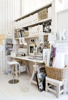 Suzie: Organized chaos  White washed panel paneled walls, white floating shelves, magazine ...