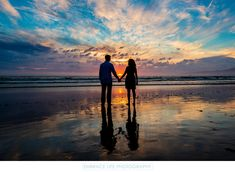 Embrace Life Photography - Silhouette Engagement Photo at Sunset, Santa Monica: Low tide and a stunning sunset during this Santa Monica beach engagement photography session provided an opportunity to create this striking silhouette portrait of a couple holding hands, taking in all the natural beauty of the Pacific coastLocation: Santa Monica, California. Keywords: Engagement (66), Portrait (295).
