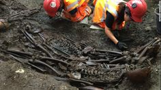 Archeologists work at a mass burial site suspected of containing 30 victims of the Great Plague of 1665, unearthed at Crossrail's Liverpool Street site in London.