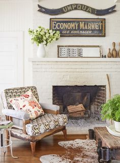 Erin found the chair in the property's barn and reupholstered it in Amy Butler fabric. The gold-leaf frame above the mantel contains strips of photo booth pictures the family takes every year at the county fair.