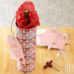 Wine Carrier -  Wine makes a great Valentine's Day gift for your loved one, set in a colorful hand-decorated carrier. Cover a cardboard cylinder with pretty scrapbook paper and attach a paper tag to the handle with a heart punched out and a message proclaiming your love.