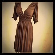 SALEDeep Brown Faux Wrap Dress w/Cinched Waist Beautiful rich brown faux-wrap top dress by Max Studio, w/puff sleeves cinched to match the waist, with lace detail on each end, adding an elegant  & feminine touch. The faux wrap top creates a v-neckline that looks stunning alone or worn w/a cami. Under the cinched waistline, the dress flares a bit at the hips, the full & airy skirt hitting below the knees, creating an extremely flattering silhouette. I absolutely love this dress, but have worn…