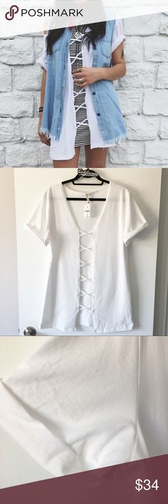 """BNWT white loop cage front boyfriend tee Brand: Emma and Sam Size: xs 31"""" in length, 22"""" in bust Light makeup stains on sleeve but washable   🌟🌟🌟🌟🌟 Rating 💯 Shop with confidence  📦 Ship same day or next day 💌 Free Brandy stickers with purchase  🛍 Bundle and save 🅿️🅿️ Accepted  ✅ Accepted  ⛔️ Trades ⛔️ Lowball offers LF Tops Tees - Short Sleeve"""