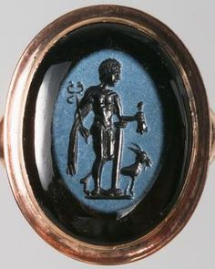 A second century ancient Roman nicolo gem, in a modern ring setting, depicting the Roman god Mercury holding his primary symbolic attribute, the caduceus and accompanied by a goat. (Kunsthistorisches Museum Vienna)