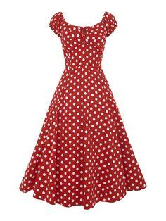 Deze Collectif dolores Doll Dress Polka Red heeft een sweetheart halslijn en gepofte mouwtjes die je ook off shoulder kan dragen.