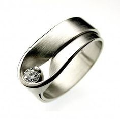Interesting setting, very modern & so different. Maybe a larger stone and possibly tourmaline instead of a diamond?