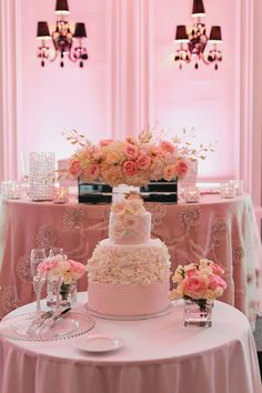 Their Wedding Cake - soo beautiful, blush with white floral fondant designs  http://www.fusion-events.ca/