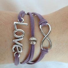Leuke armband met tussenstukken 'Love' en 'Infinity'. Gemaakt met suede veter. € 9,95