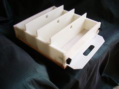 This is a soap mold that will hold 12-14 lbs of soap. It has three removable dividers that separate the mold into four individual logs. With this mold you can make four different logs of soap, or take out one or all of the dividers and make one big block of soap. You can even…
