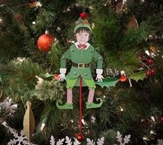 """<p>Create yourself as an elf! </p><p>This project can easily be assembled with brads to create a pose able elf, or you can add strings to create a """"Jumping Jack"""" puppet. For a quick, fun kids craft, use the Contour tool to remove the circle-shaped holes and let them build the elf with glue! </p><p>There is also a plain, black and white version that can be colored by your little artist before assembling.</p>"""