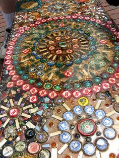 love this idea. (but i'd probably use brighter colors). putting bottle caps under glass for a table.
