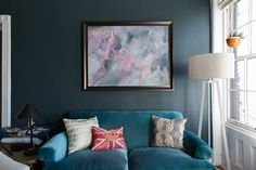 The Willoughby Settee from Anthropologie sits under a beautiful painting by Colleen Keeley. The pinks and blues tie into the next room as well as the hallway.
