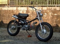 Saw this on Photo Bucket from a forum. Extremely nice rework / rebuild of a Honda CT90!