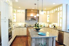 Oh My.... I am in glass front cabinet heaven!  What a gorgeous kitchen.