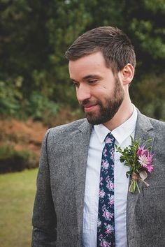 Groom in white shirt with brightly colored floral tie. @myweddingdotcom