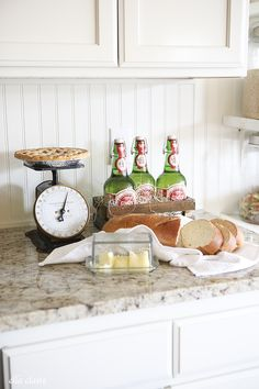 Sweet kitchen still life-- so invitingly simple:  bread and bottle sodas, creamy butter and a pie!.