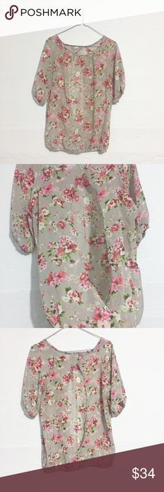 Open Back Floral Blouse No sizing information, but fits like a medium. Adorable open back. Open to offers. No trades. Tops Blouses