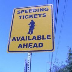 Anyone who has been on a road trip or moved from one place to another knows that they don't want to see the red, white and blue lights flashing behind them. This street sign lets you know what lies ahead on the road if you speed!   On the Road